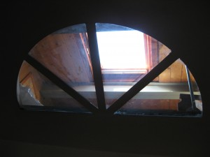 Skylight to the semi-furnished attic.  Unfortunately the door is locked so we can't see all of what's up there.