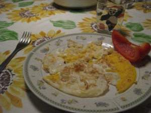 "First fried eggs meal (my mom knows how I feel about this meal!) - not quite as ""clean"" looking as at home, but delicious! And yes that is a Kung Fu Panda glass."