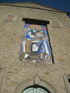 A cool mosaic on one of the buildings.