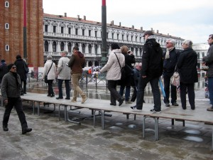 In the morning, St. Mark's square had some flooding!  We had to use these platforms to walk across some areas.